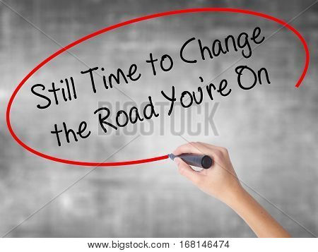 Woman Hand Writing Still Time To Change The Road You're On With Black Marker Over Transparent Board