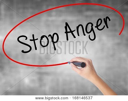 Woman Hand Writing Stop Anger With Black Marker Over Transparent Board