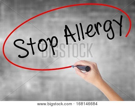 Woman Hand Writing Stop Allergy  With Black Marker Over Transparent Board