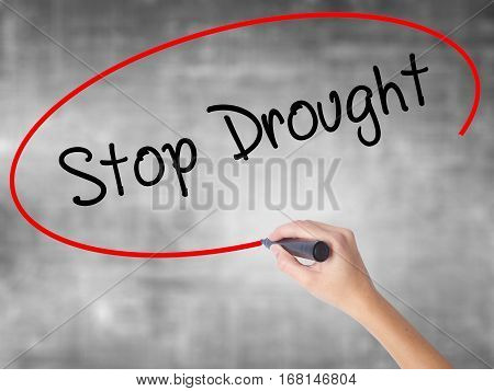 Woman Hand Writing  Stop Drought With Black Marker Over Transparent Board