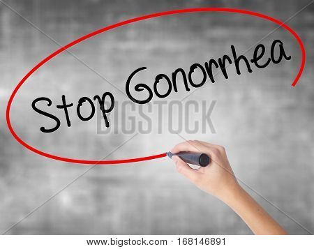 Woman Hand Writing Stop Gonorrhea With Black Marker Over Transparent Board.
