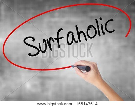 Woman Hand Writing Surfaholic  With Black Marker Over Transparent Board