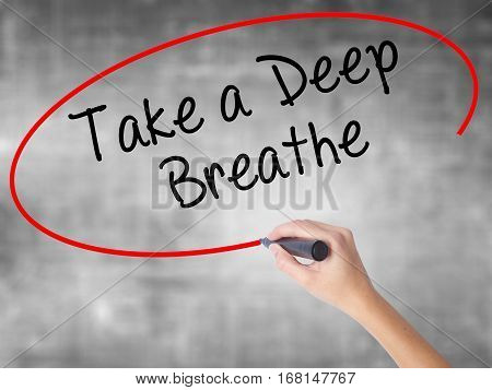 Woman Hand Writing Take A Deep Breathe With Black Marker Over Transparent Board