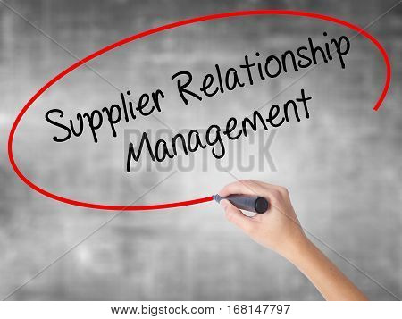 Woman Hand Writing Supplier Relationship Management With Black Marker Over Transparent Board.