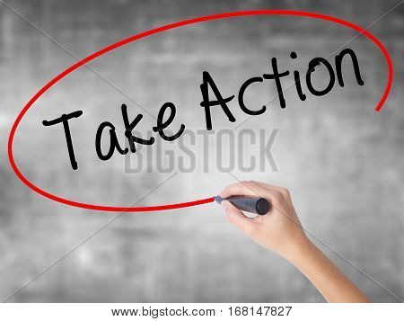 Woman Hand Writing Take Action With Black Marker Over Transparent Board