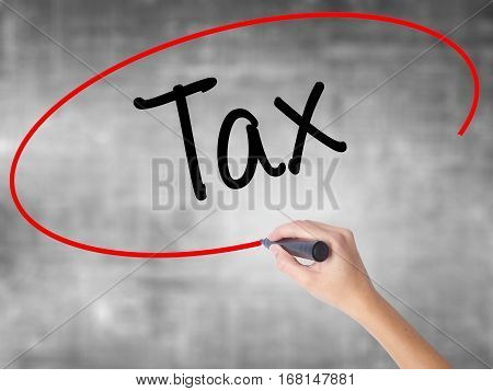 Woman Hand Writing Tax With Black Marker Over Transparent Board