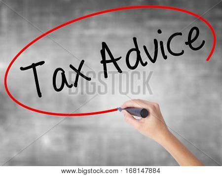 Woman Hand Writing Tax Advice With Black Marker Over Transparent Board