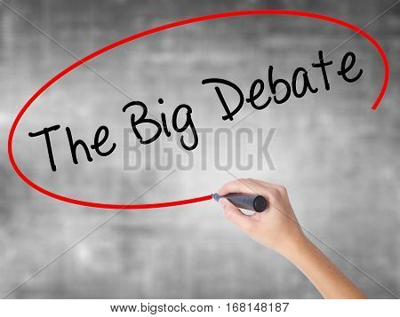 Woman Hand Writing The Big Debate With Black Marker Over Transparent Board