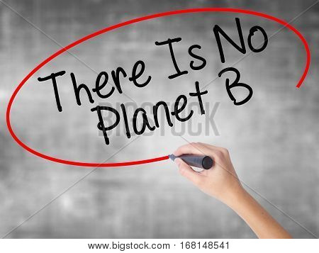 Woman Hand Writing There Is No Planet B With Black Marker Over Transparent Board