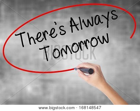 Woman Hand Writing There's Always Tomorrow  With Black Marker Over Transparent Board