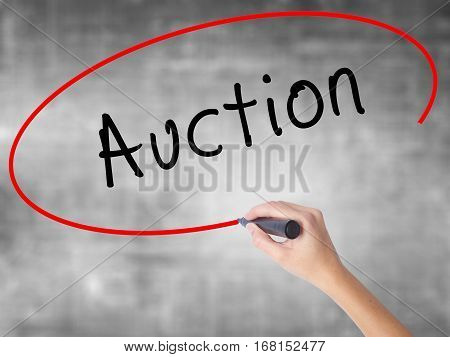 Man Hand Writing Auction With Black Marker On Visual Screen