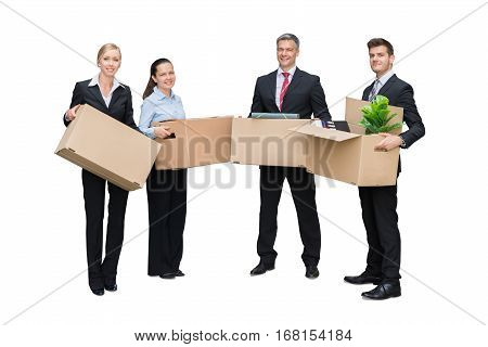 Successful Businesspeople With Cardboard Boxes Moving To Their New Office