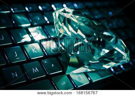 Diamond on the Computer Keyboard Conceptual Photo.