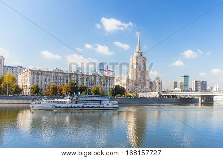 MOSCOW - SEPTEMBER 15 2015: Radisson Royal Hotel (Hotel Ukraina) with pleasure boat on the foreground.
