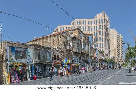 JERUSALEM, ISRAEL - MAY 22, 2016: Jaffa street morning life, one of the longest and oldest major streets lined with shops and businesses.
