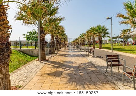 TEL AVIV, ISRAEL - MAY 22, 2016: People walking the long promenade Israel National Trail.
