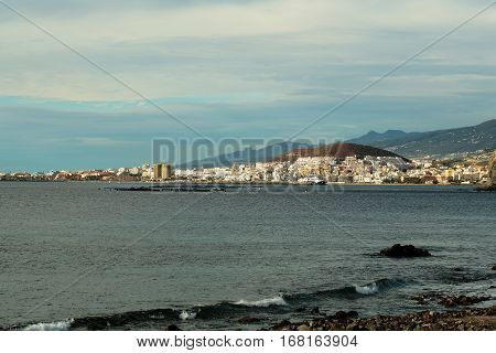Beautiful resort town at sea side on mountain coast on sunny day on blue sky background