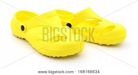 Closeup yellow rubber shoes on white background.