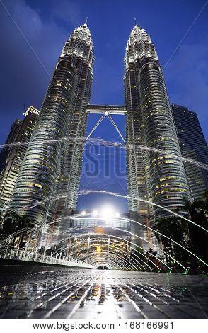 KUALA LUMPUR,MALAYSIA - JANUARY 10, 2017: The Petronas Towers, the famous fountains in Kuala Lumpur, Malaysia