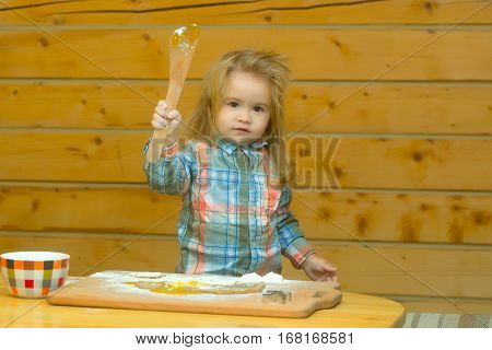 Cute Child Cooking With Dough, Flour Holds Wood Shovel