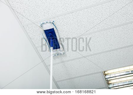 Close-up Of Mop Wiping On The Ceiling Of The House