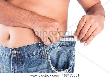 Man abdomen with measuring tape ,after weight loss
