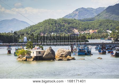 Boats And Rocks Near Fishing Village On The River Kai In Nha Trang