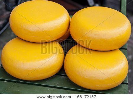 Dutch Gouda cheese wheels in a cheese marke