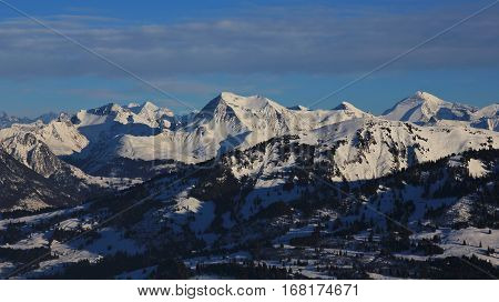 Snow covered mountains in the Bernese Oberland. Beautiful view from the Rellerli ski area Switzerland. Mount Albristhorn and Rinderberg in winter.