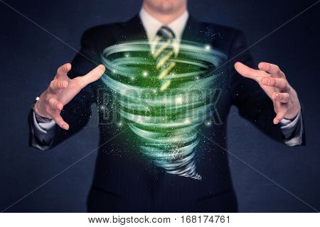 Bright green tornado in the hands of a businessman