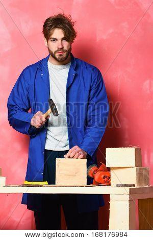 Builder Man Holding Hummer