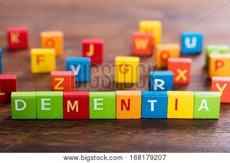 Dementia Text On Multi Colored Cubes On Wooden Table