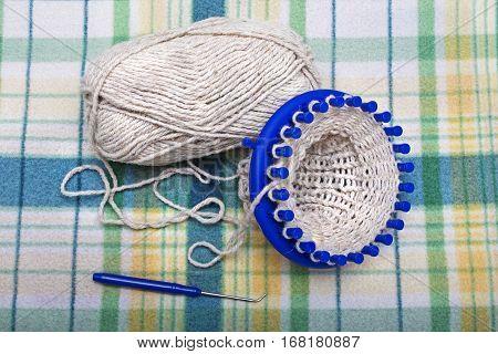 process of knitting wool socks on a circular loom homemade crafts