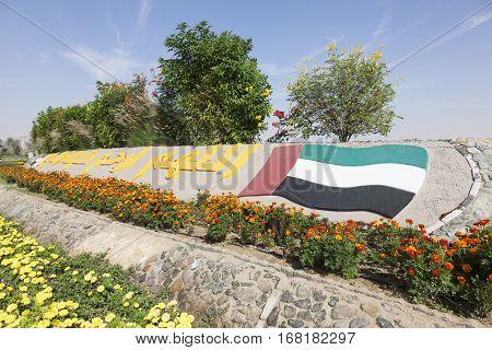 MEZAIRAA, UAE - DEC 4, 2016: UAE national flag monument in a roundabout in Liwa Oasis. Emirate of Abu Dhabi United Arab Emirates Middle East