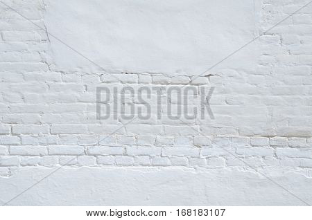 Texture of old white and gray brick wall surface with cement and concrete seams