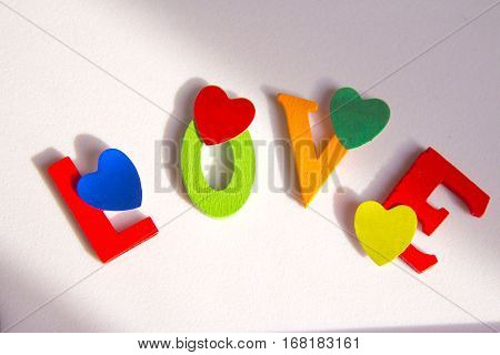 Word love made with wood letters in diferent colors