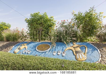 MEZAIRAA, UAE - DEC 4, 2016: Traditional arabian coffeepot monument in the desert town Mezairaa Emirate of Abu Dhabi Liwa area United Arab Emirates