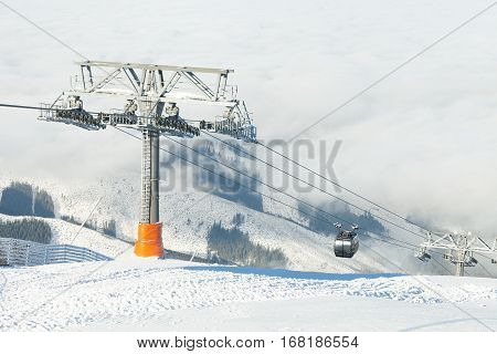 New Cable Cars Going Up And Down The Mountains At A Winter Sports Resort Area On A Sunny Day