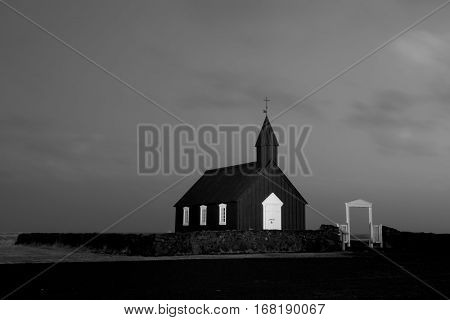 An old church in a remote countryside in Iceland during a rainy, stormy evening