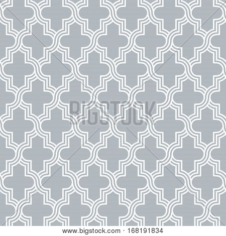 Traditional quatrefoil grey lattice pattern. Seamless vector background.