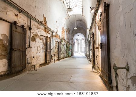 Jail hallway with locked doors.