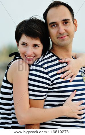 Happy Couple Are Hugging On The Sea