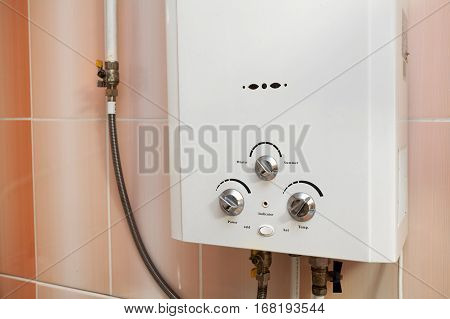 Gas water heater on the wall in kitchen