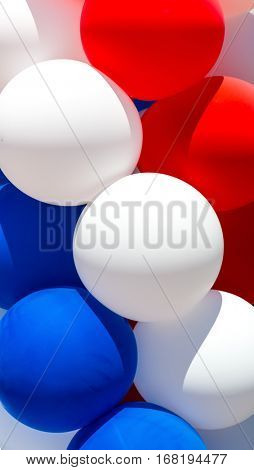 Close up of tricolor balloons.