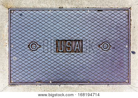 USA lettering on a steel manhole cover.