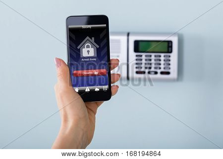 Security Alarm Keypad With Person Disarming The System With Remote Controller