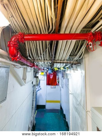 Partitions with pipe and wires on aircraft carrier