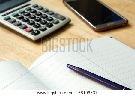 Note book with pen, calculator, smart phone