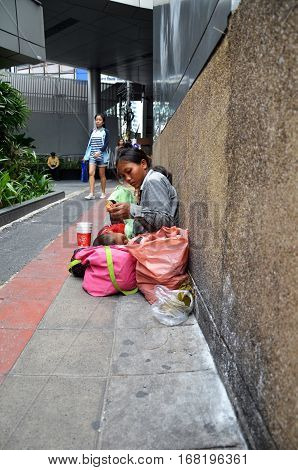 BANGKOK THAILAND - JAN 21 2017: Thailand women begging on the overpass in Bangkok Thailand