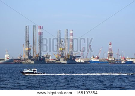 SINGAPORE - JAN 15 2017: Police secure the sea around industrial zone in Singapore.